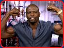 bodybuilder terry crews blue shirt double biceps goatee